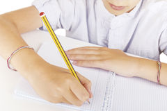 Child writing with a pencil Stock Photography