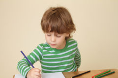 Child Writing, School Education Stock Photo