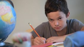 Child writing at school stock video footage