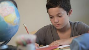 Child writing at school stock footage