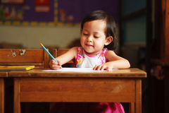 Child writing and smile Stock Photos