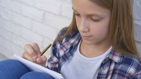 Child Writing, Studying, Thoughtful Kid, Pensive Student Learning Schoolgirl royalty free stock photo