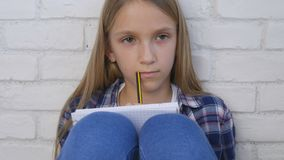 Child Writing, Studying, Thoughtful Kid, Pensive Student Learning Schoolgirl stock photography