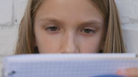 Child Writing, Studying, Thoughtful Kid, Pensive Student Learning Schoolgirl stock images