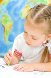 Child is writing using a pen Royalty Free Stock Photos