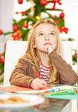 Child writing wishlist for Royalty Free Stock Photos