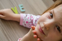 Child is Writing Word Love From Colorful Toy Letters Royalty Free Stock Photos