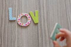 Child is Writing Word Love From Colorful Toy Letters Royalty Free Stock Photo