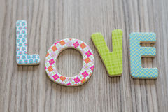 Child is Writing Word Love From Colorful Toy Letters Stock Photography