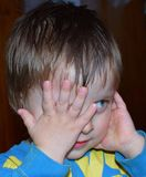 Child's covering the face Royalty Free Stock Photography