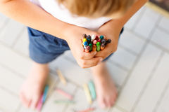Child& x27;s hands with lots of colorful wax crayons Stock Images