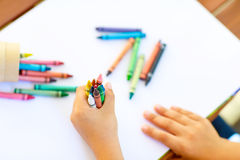 Child& x27;s hands with lots of colorful wax crayons Royalty Free Stock Photography