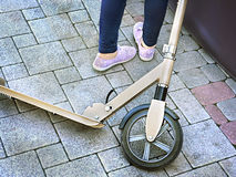 Child's legs and a metal scooter Royalty Free Stock Photos