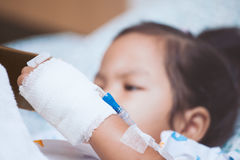 Child& x27;s patient hand with saline intravenous & x28;iv& x29; drip Royalty Free Stock Images