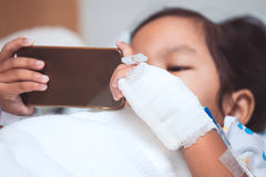 Child& x27;s patient hand with saline intravenous & x28;iv& x29; drip Stock Photography