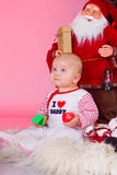 Child with xmas decoration Royalty Free Stock Photo