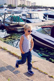 Child with yachts Stock Images
