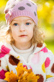 Child with yellow leaves Royalty Free Stock Photo