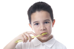 Child with yellow tooth brush and shirt collar down. Royalty Free Stock Photos