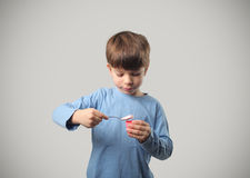 Child and yoghurt Stock Images