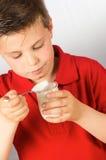 The child of yogurt 2. Photograph of a child eating yogurt over white background Stock Image