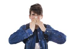 Child or young boy sneezing with isolated royalty free stock image
