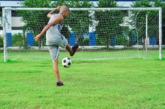 Child Young Boys Kicking Soccer Ball. Kid Playing Soccer. royalty free stock photos
