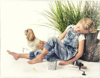 Child or young girl with her dog taking a nap or sleeping while Royalty Free Stock Images