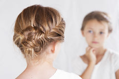 Child or young girl staring at herself in a mirror royalty free stock photos
