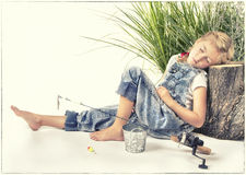 Child or young girl taking a nap or sleeping while fishing Stock Images