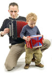 Child and young man playing the accordion Royalty Free Stock Photo
