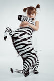 Child with zebra stock image