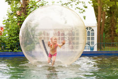 Child in zorb Stock Photos
