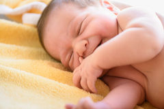 After childbirth newborn baby. Smile in a bed with a diaper stock photography