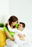 Childcare. Family of mother and son having good time at home royalty free stock images