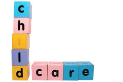 Childcare in block letters with clipping path. Assorted childrens toy letter building blocks against a white background that spell childcare with clipping path stock photo