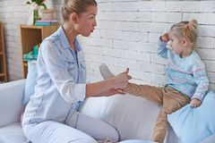 Childcare. Pretty young women taking care of her daughter royalty free stock photography
