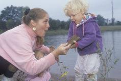 A childcare worker playing with children by a lake, Washington D.C. Royalty Free Stock Photos