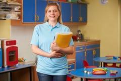 Childcare Worker Standing In Nursery. Portrait Of Childcare Worker Standing In Nursery royalty free stock image