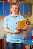 Childcare Worker Standing In Nursery Royalty Free Stock Photos