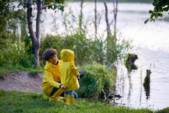 Childcare. Young mother taking care of her child during outdoor rest royalty free stock images