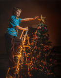 Childe have a Christmas. Adorable boy dressed Christmas tree Stock Images