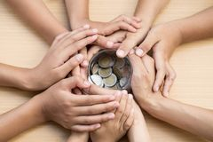 Childen and adult holding money jar, donation, saving concept royalty free stock photo