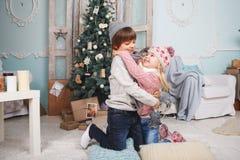 Childen around the Christmas tree Stock Photos