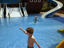 Childeren in swimming pool. Holiday in Mallorca Stock Photos