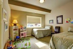 Childerns' bedroom with window. Stock Photo