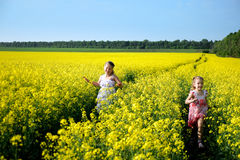 Childhood. An image of two girls running in the field royalty free stock photos