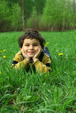 The childhood. Spring day. Game on a meadow with dandelions Stock Photo