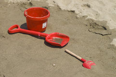 Childhood. Close up of Shovel and Pail Waiting for the Tide Stock Image