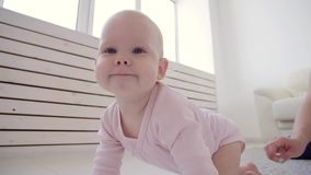 Childhood, babyhood and family concept. Mother playing with her cute baby at home stock video footage